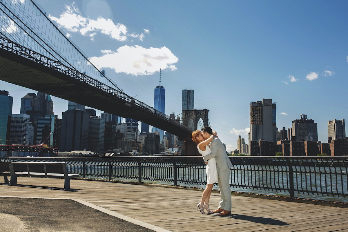 engaged-couple-kiss-brooklyn-bridge-park-ny-photography
