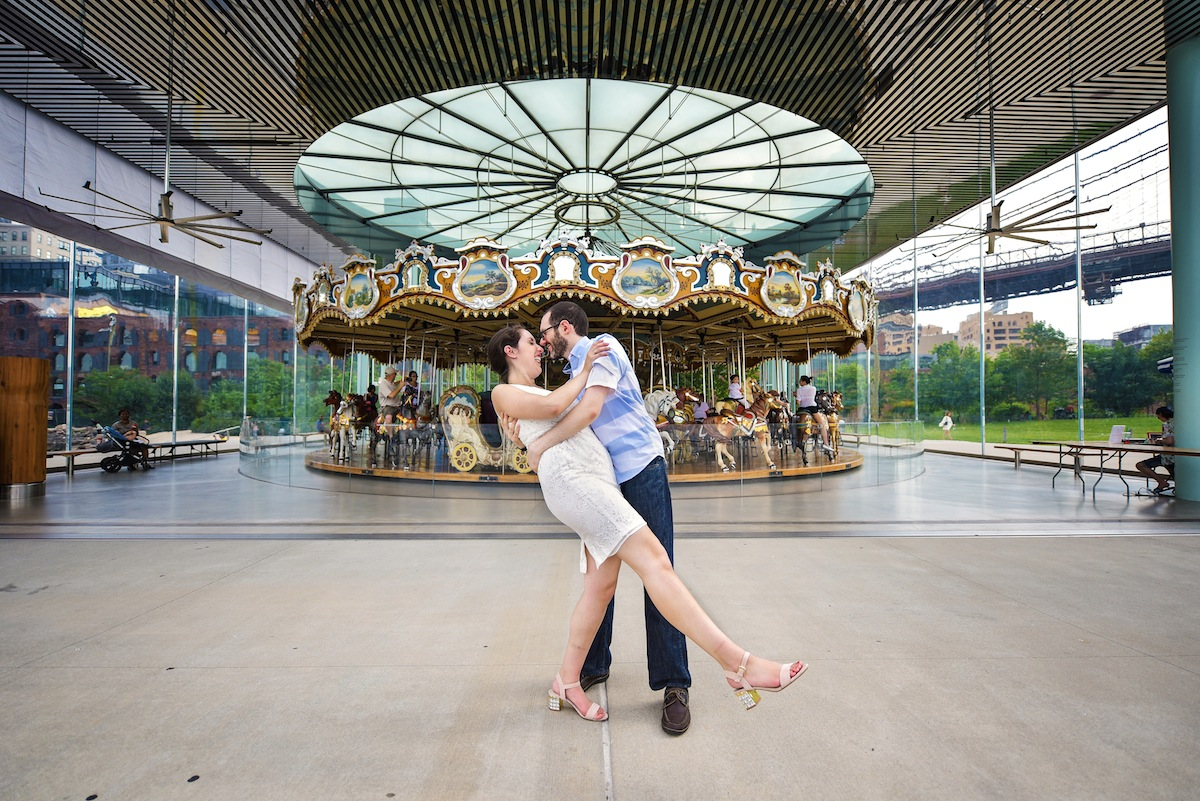 engaged-couple-dip-by-carousel-in-park-ny-photography