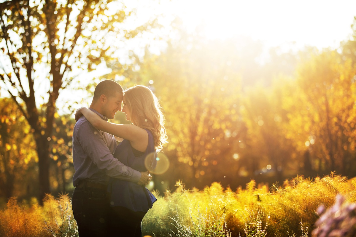 engaged-couple-embrace-at-dusk-in-park-nj-photography