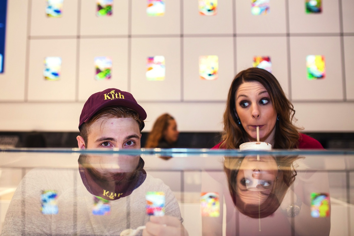 alex-and-laura-peeking-over-counter-in-store-in-ny-photography-engagement