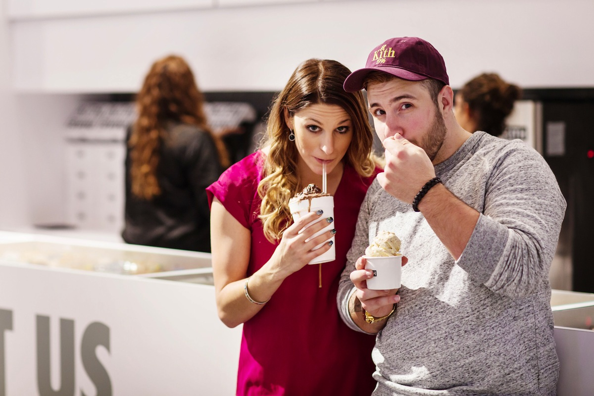 laura-and-alex-eating-yogurt-in-nyc-engagement-photos