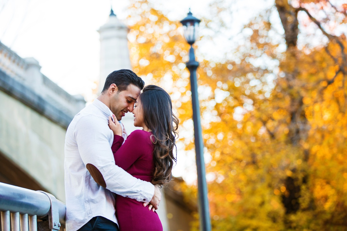 jason-and-stephani-embracing-on-bridge-in-park-new-jersey-engagement-photography