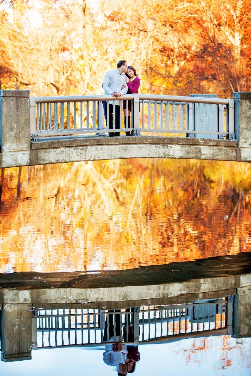 jason-and-stephani-standing-on-bridge-in-park-nj-engagement-photography