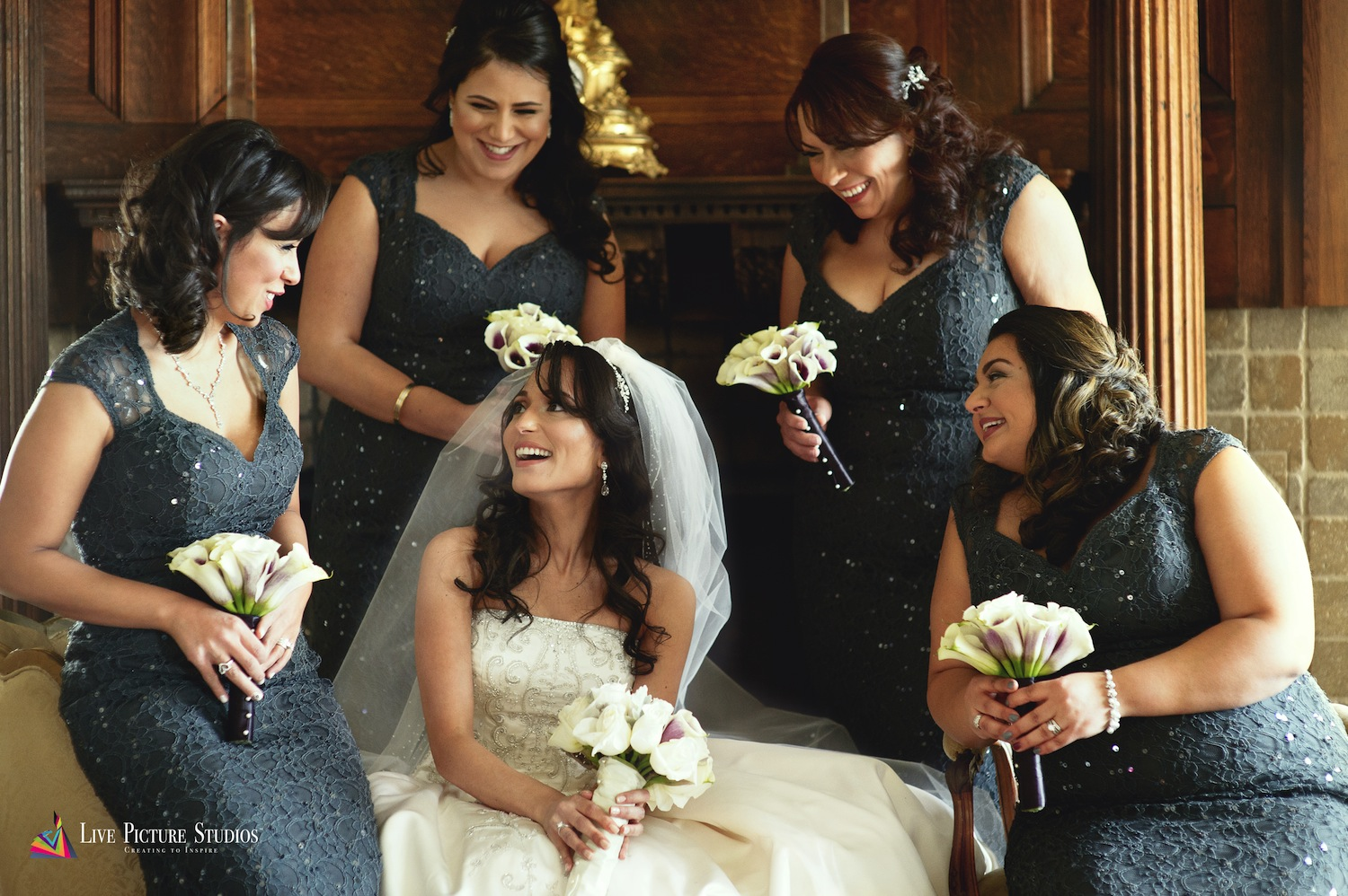 dolly-and-bridesmaids-holding-bouquets-and-laughing-before-wedding-photography-nj