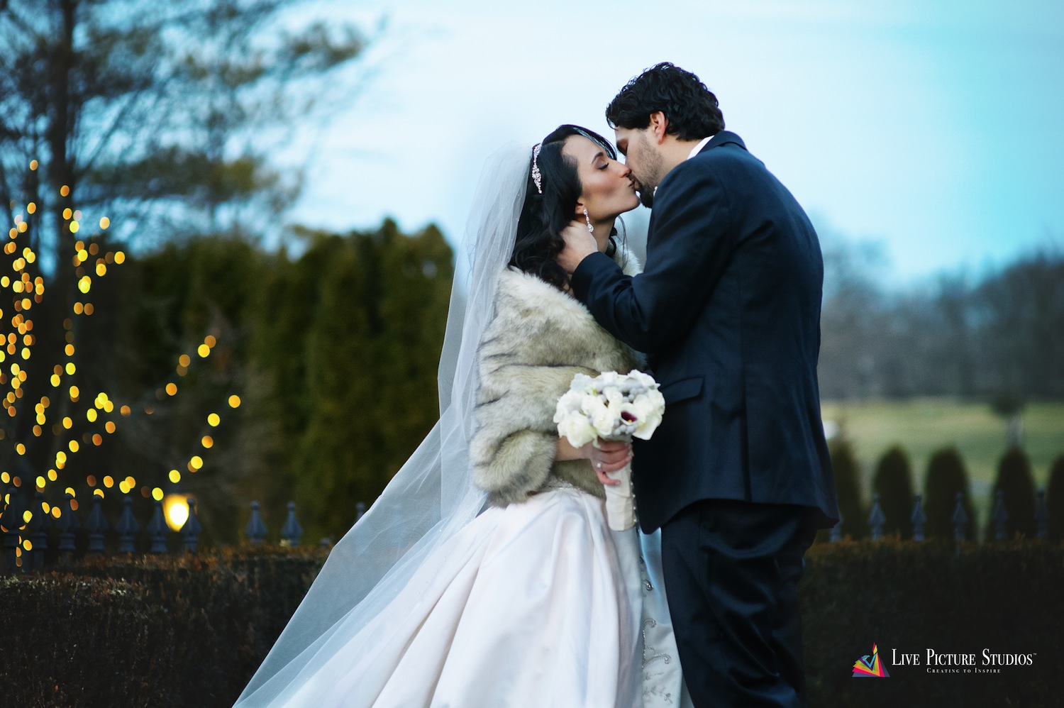 dolly-and-jordan-kissing-outside-venue-nj-wedding-photography
