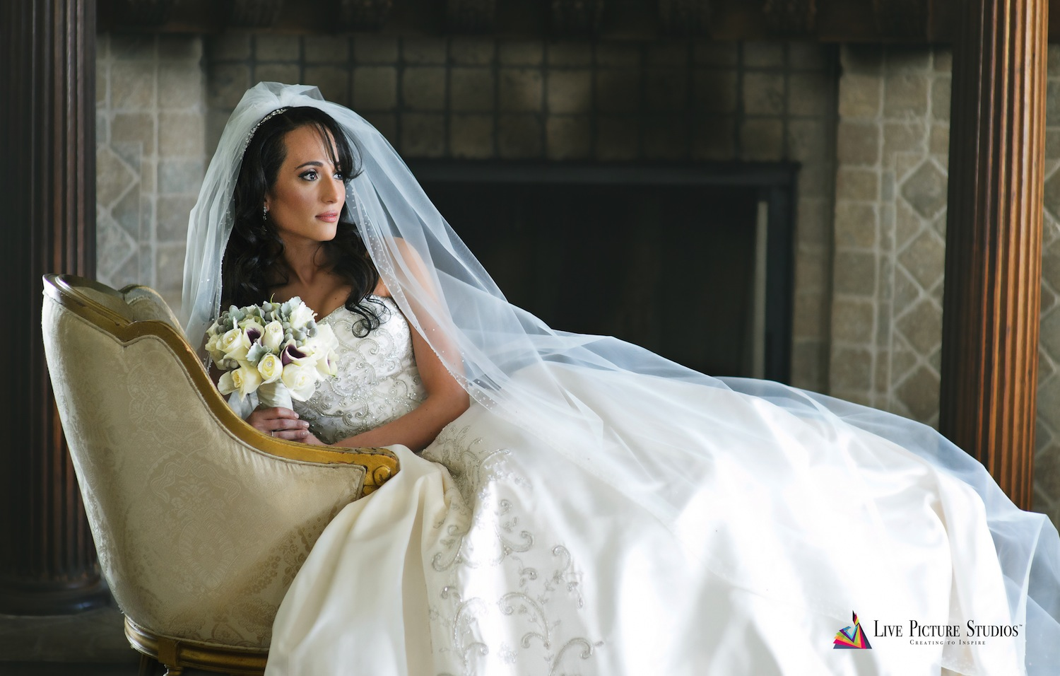 dolly-lying-on-couch-in-wedding-dress-with-bouquet-nj-wedding-photography