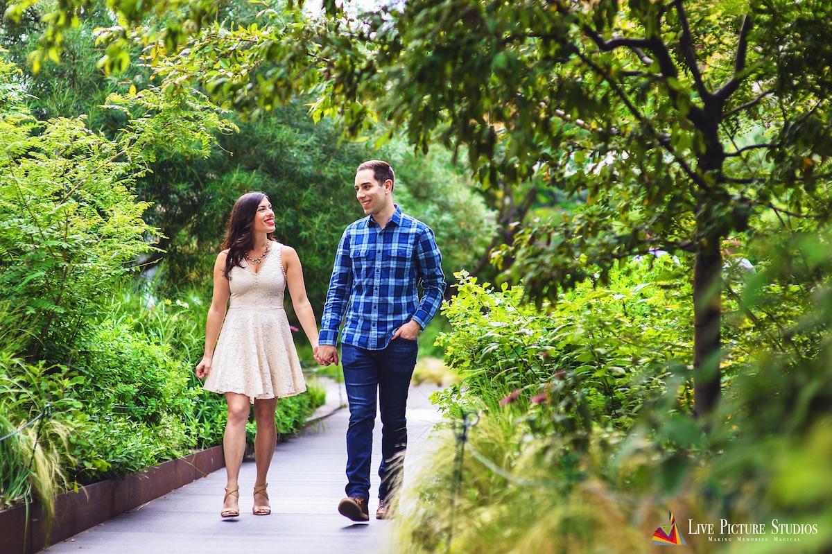 engaged-couple-walking-park-nyc-wedding-photography