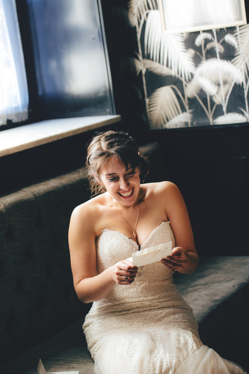 jamie-reading-jonathans-letter-and-smiling-in-wedding-photography-nyc