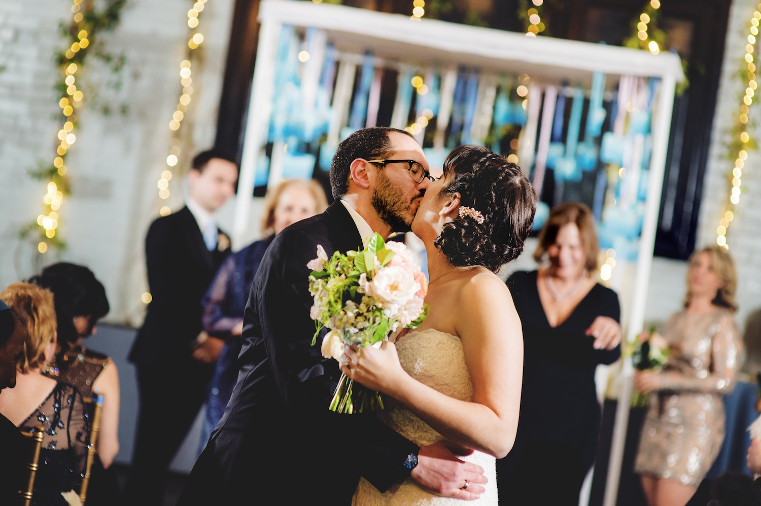 jonathan-and-jamie-kissing-in-aisle-in-wedding-photography-nyc
