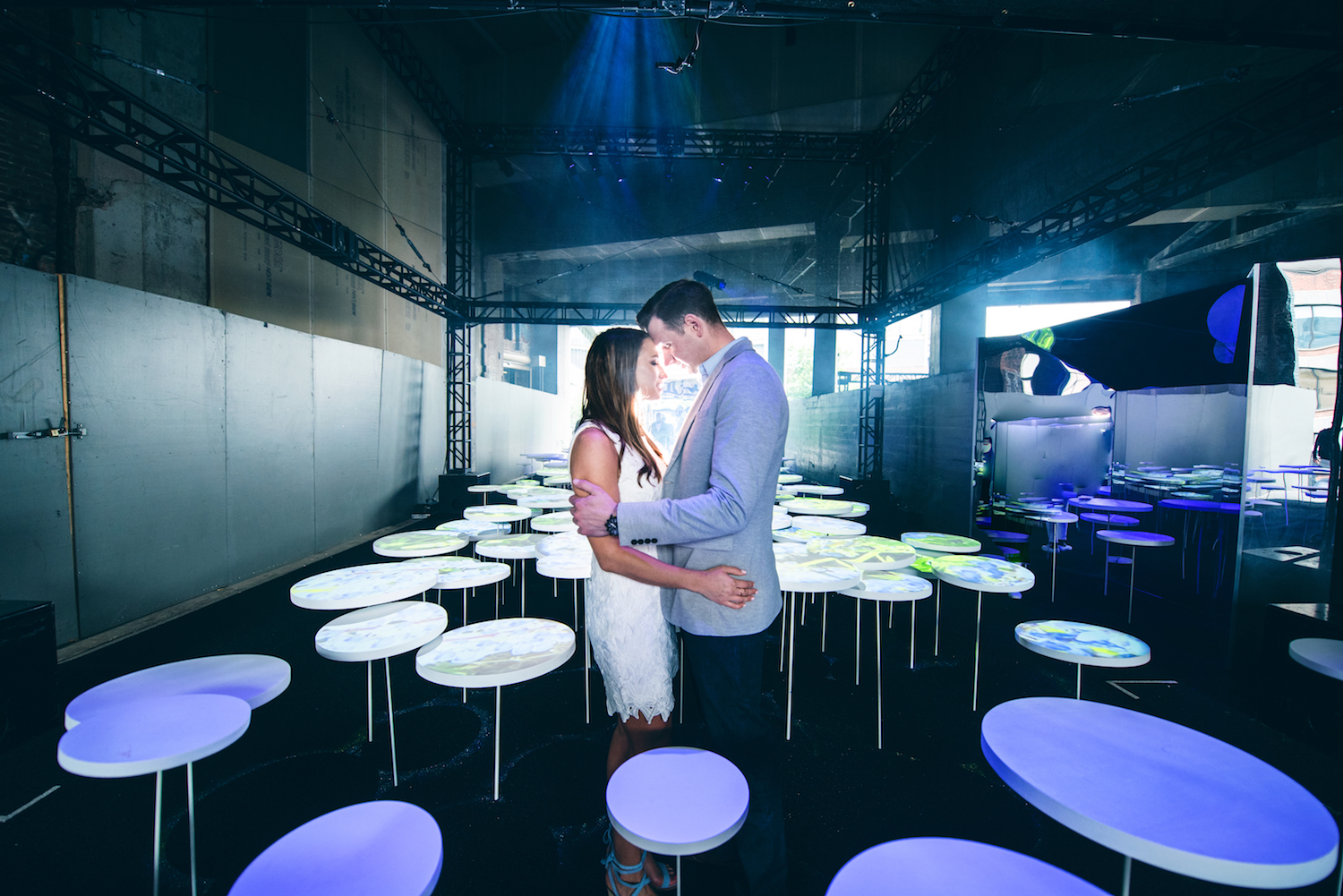 kayla-&-mike-embracing-in-club-restaurant-nyc-engagement-photography-nj