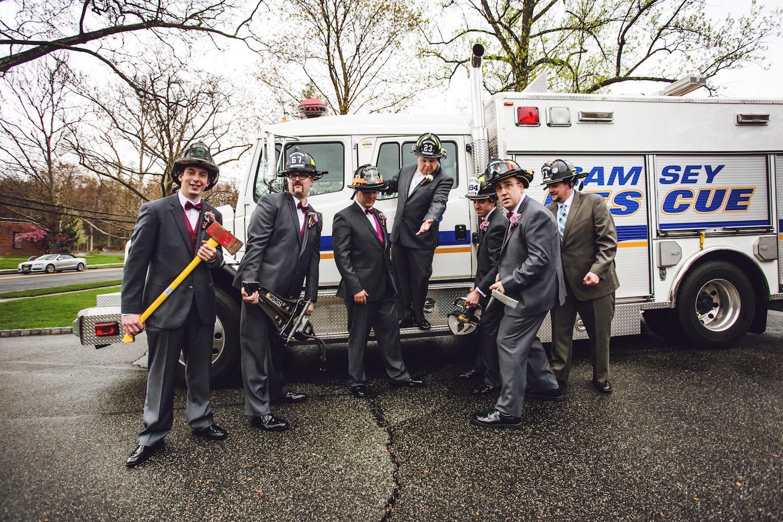 richard-&-groomsmen-in-fire-gear-by-rescue-truck-nj-wedding-photography