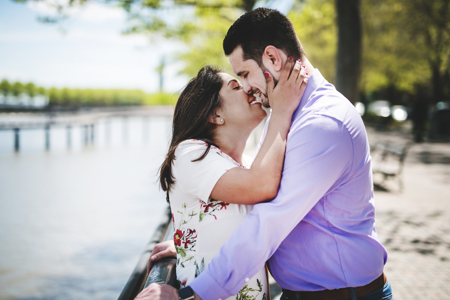 stephanie-&-charles-embracing-and-smiling-by-water-engagement-photos-nj