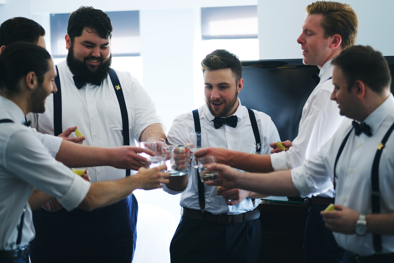 alex-&-groomsmen-toasting-glasses-groom-prep-wedding-photography-nj