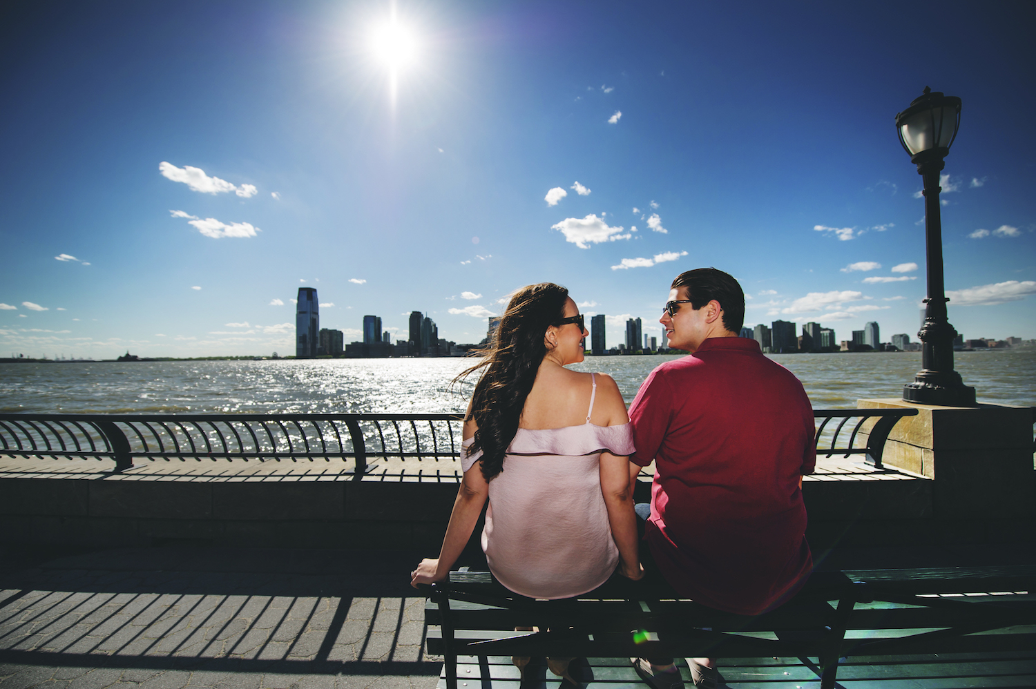clarissa&jesse-sitting-bench-in-sunglasses-nyc-engagement-photos