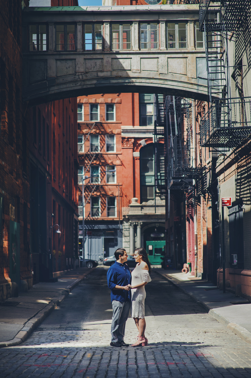 jesse&clarissa-embracing-in-old-city-street-nyc-engagement-photos