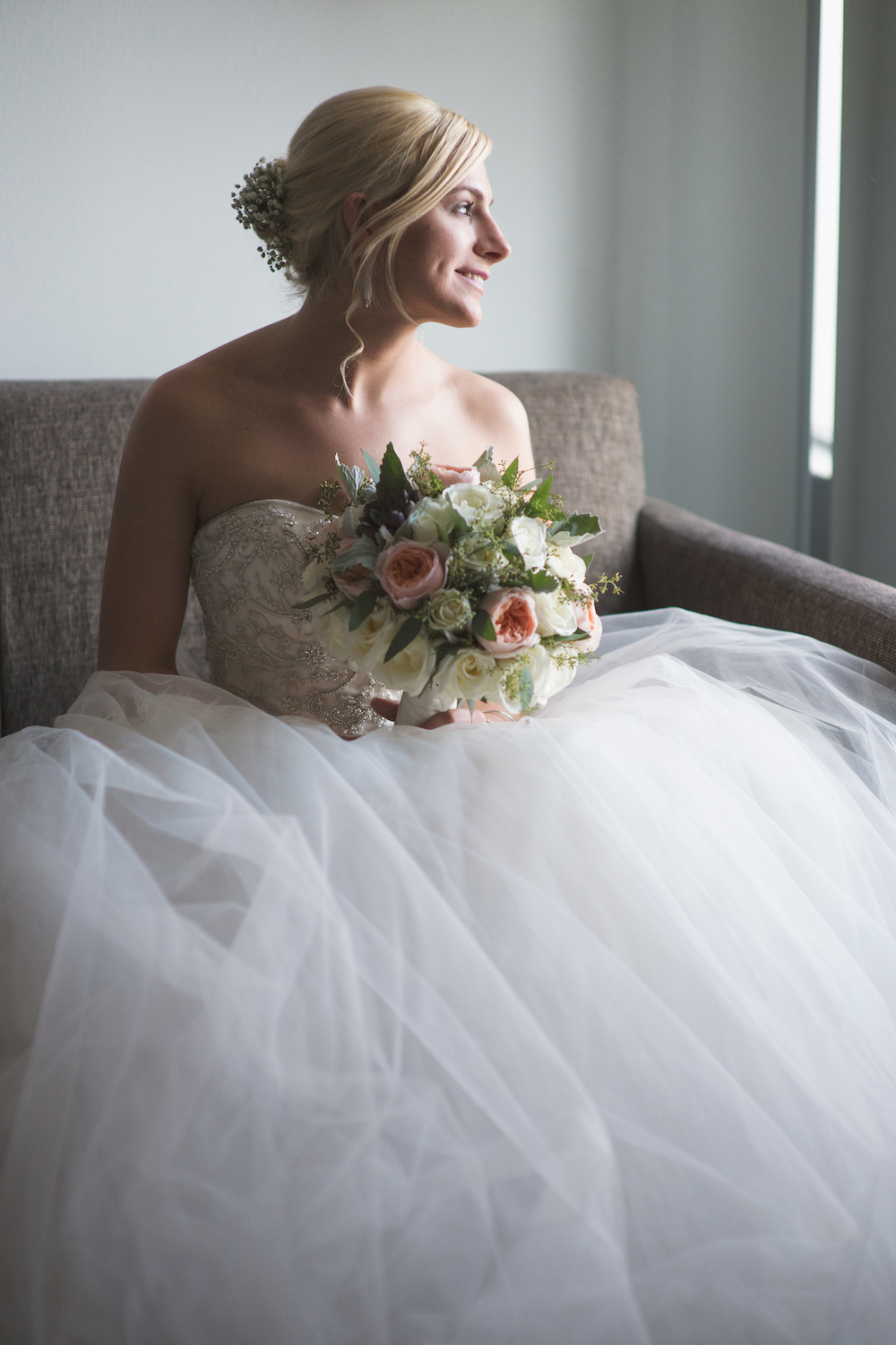 laura-in-dress-with-bouquet-looking-out-window-wedding-photos-nj