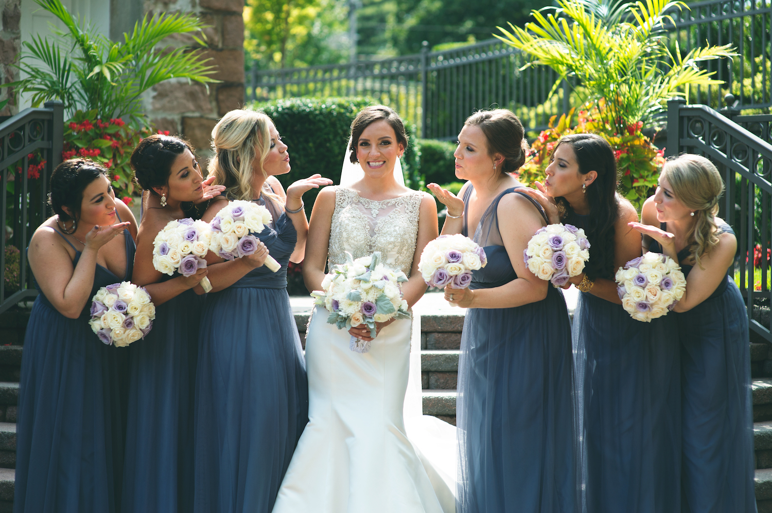 clarissa-smiling-bridesmaids-blowing-kisses-wedding-photography-nj