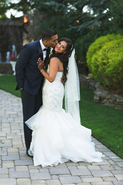 jerry-kissing-sherrys-cheek-outside-nj-wedding-photography