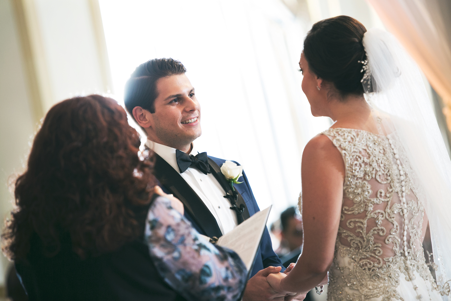 jesse&clarissa-holding-hands-at-altar-wedding-photography-nj