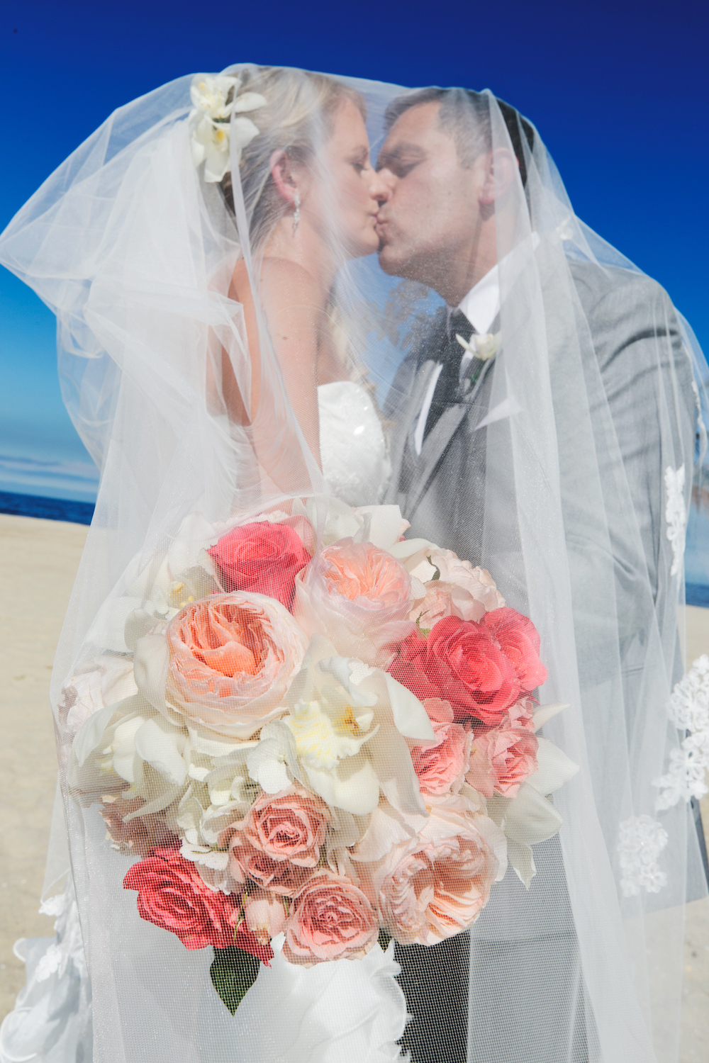 kimberley&charles-kissing-under-veil-on-beach-wedding-photography-nj