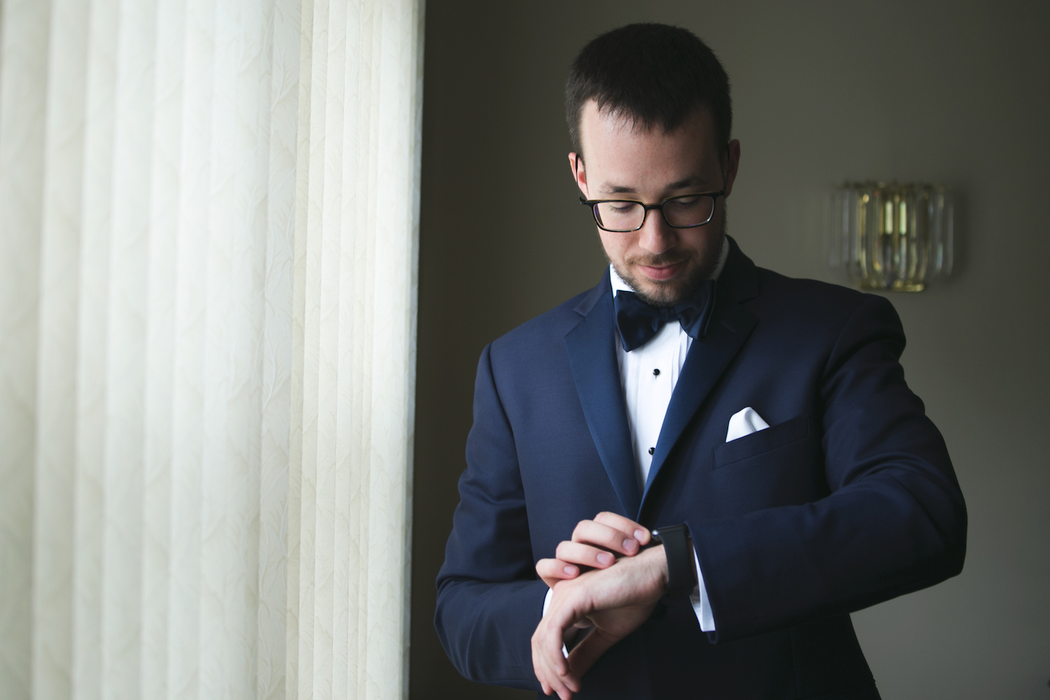 mike-in-tux-checking-watch-groom-prep-nj-wedding-photography
