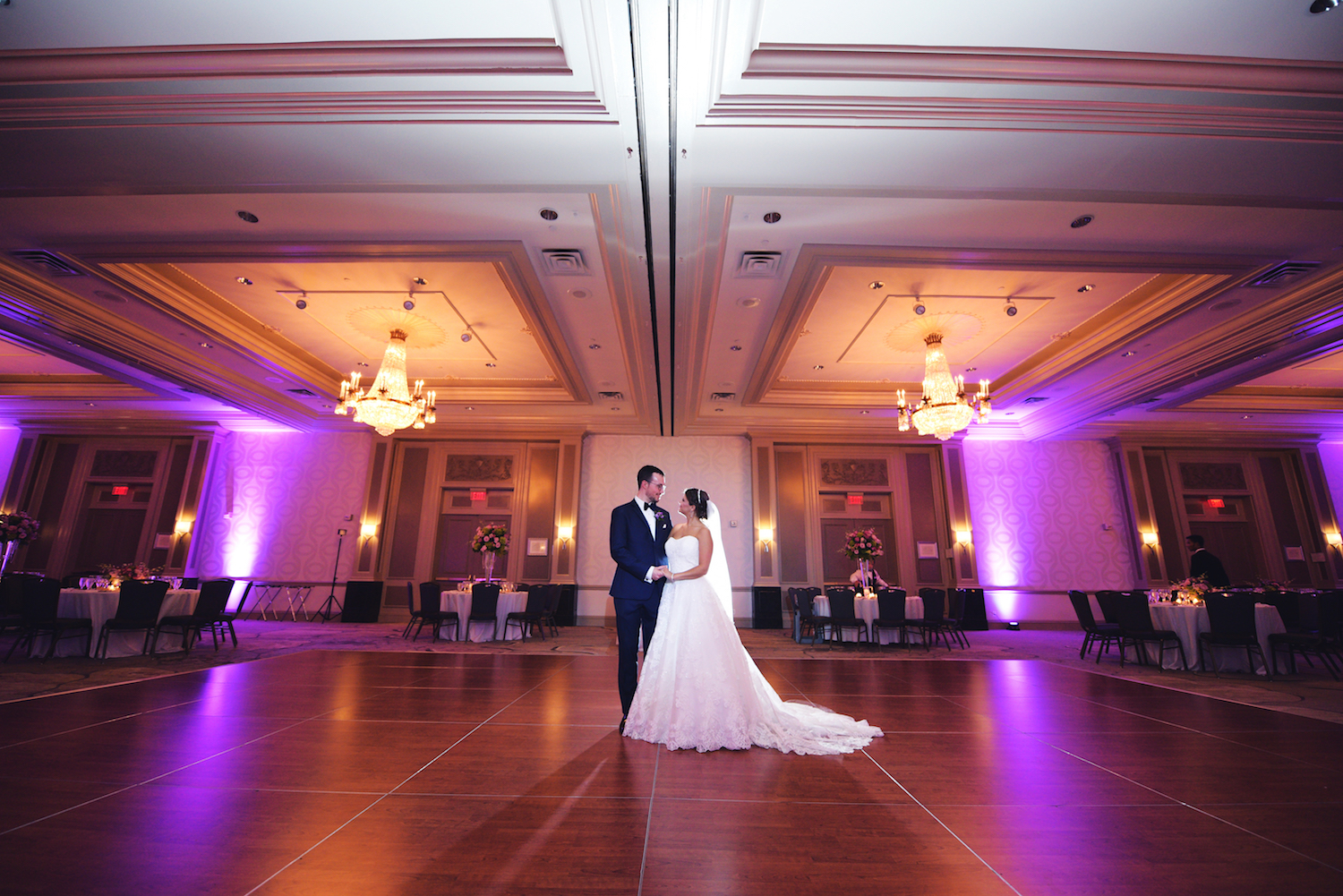 mike&samantha-embracing-on-empty-dance-floor-ballroom-wedding-photography-nj