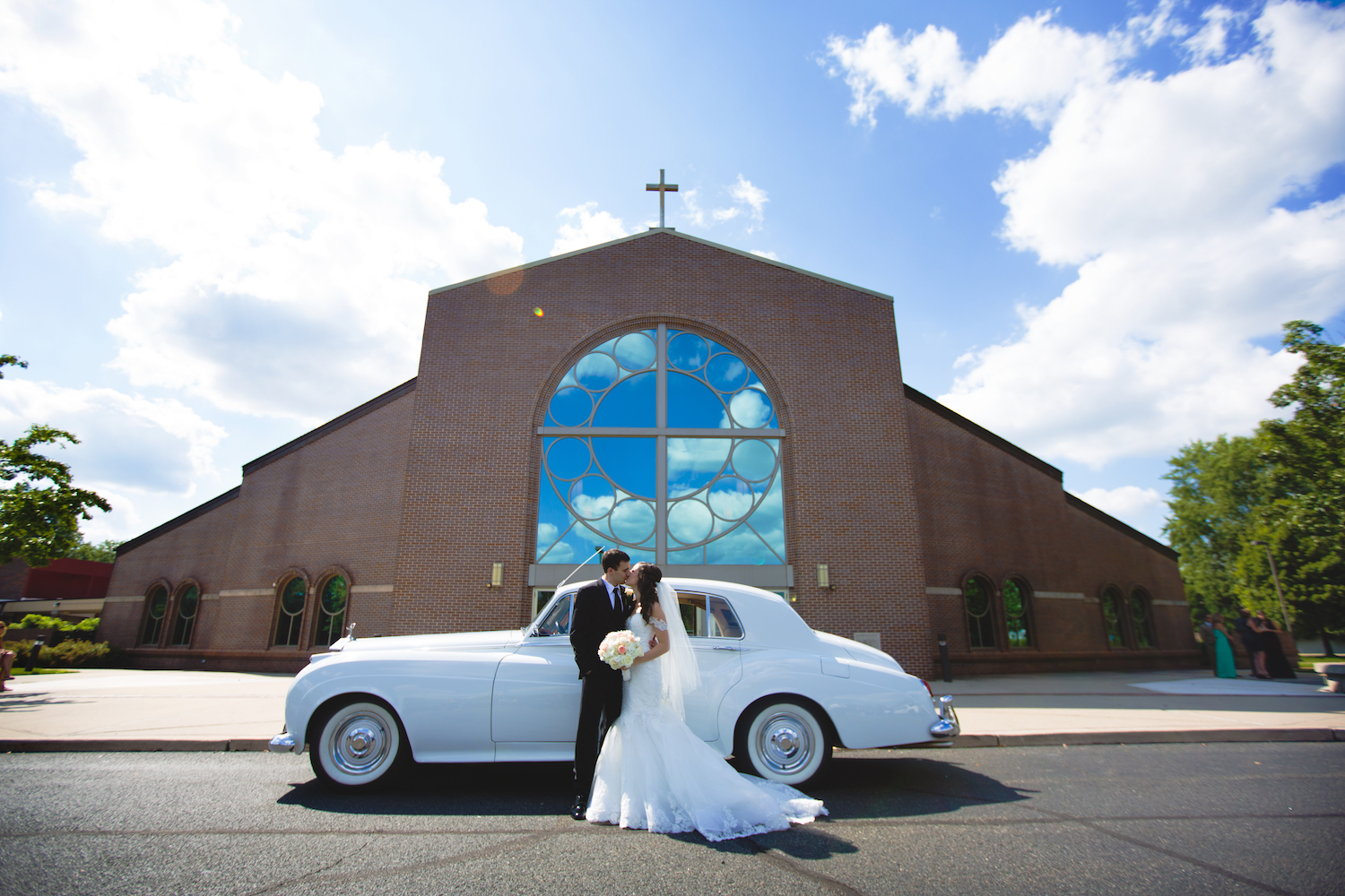 scott&jessica-kissing-by-car-church-nj-wedding-photography