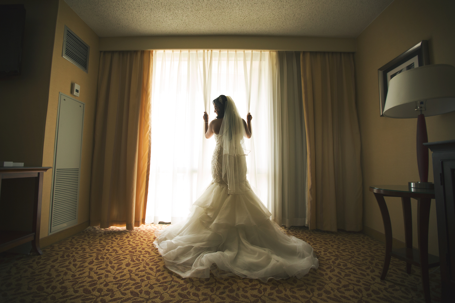 sherry-at-window-in-dress-wedding-photography-nj