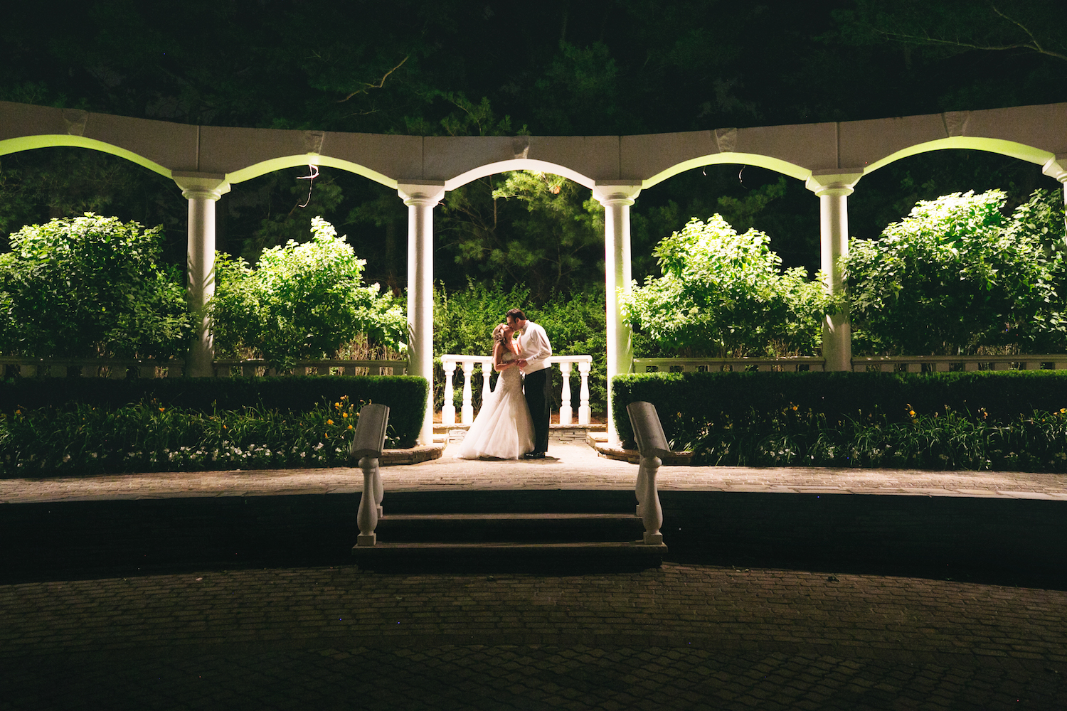 tricia&anthony-kissing-on-venue-grounds-night-nj-wedding-photography