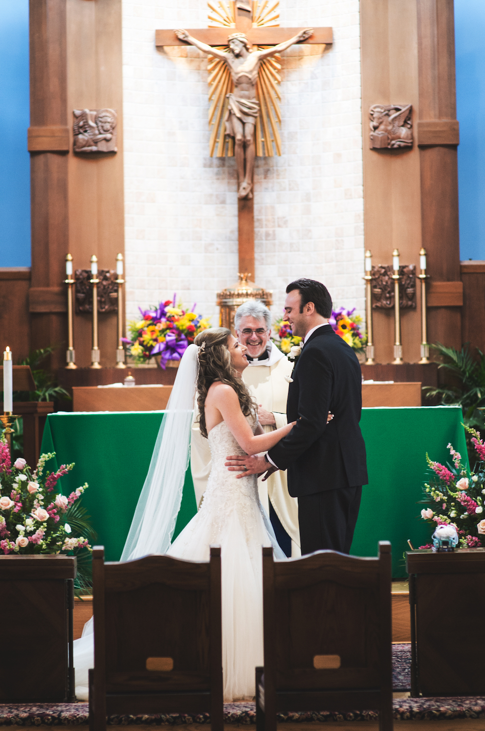 tricia&anthony-laughing-at-altar-nj-wedding-photography