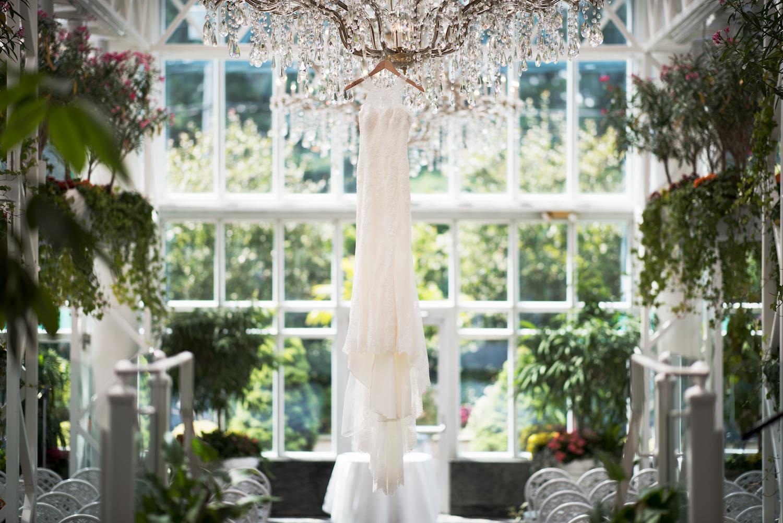 christines-wedding-dress-hanging-in-conservatory-nj-wedding-photography