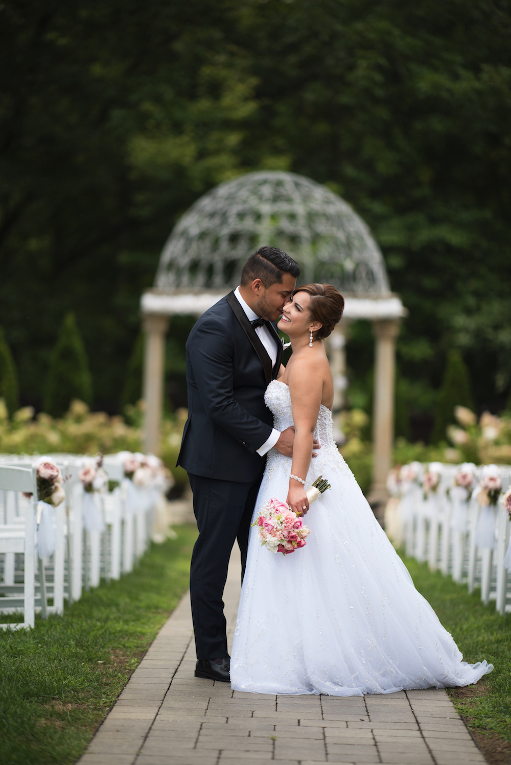 jay-kissing-annette-in-aisle-ceremony-wedding-photography-nj