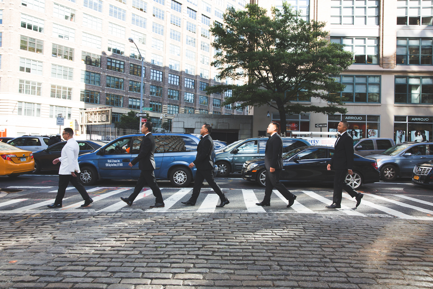 jason-groomsmen-walking-in-line-city-street-nyc-wedding-photography