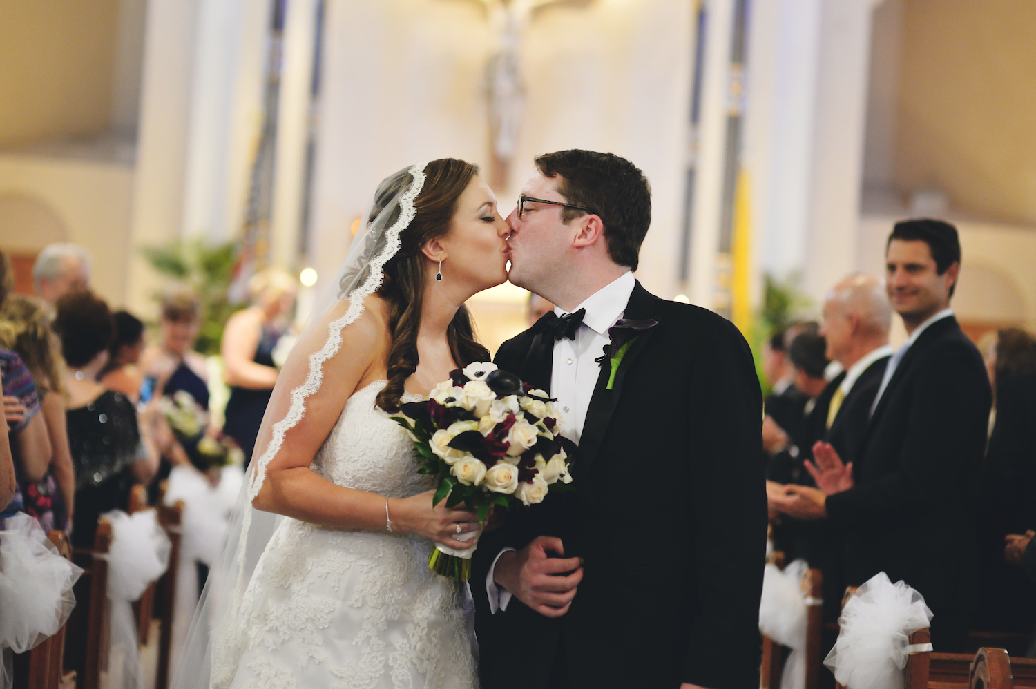 alison&brian-kissing-in-aisle-church-ceremony-wedding-photos-nyc