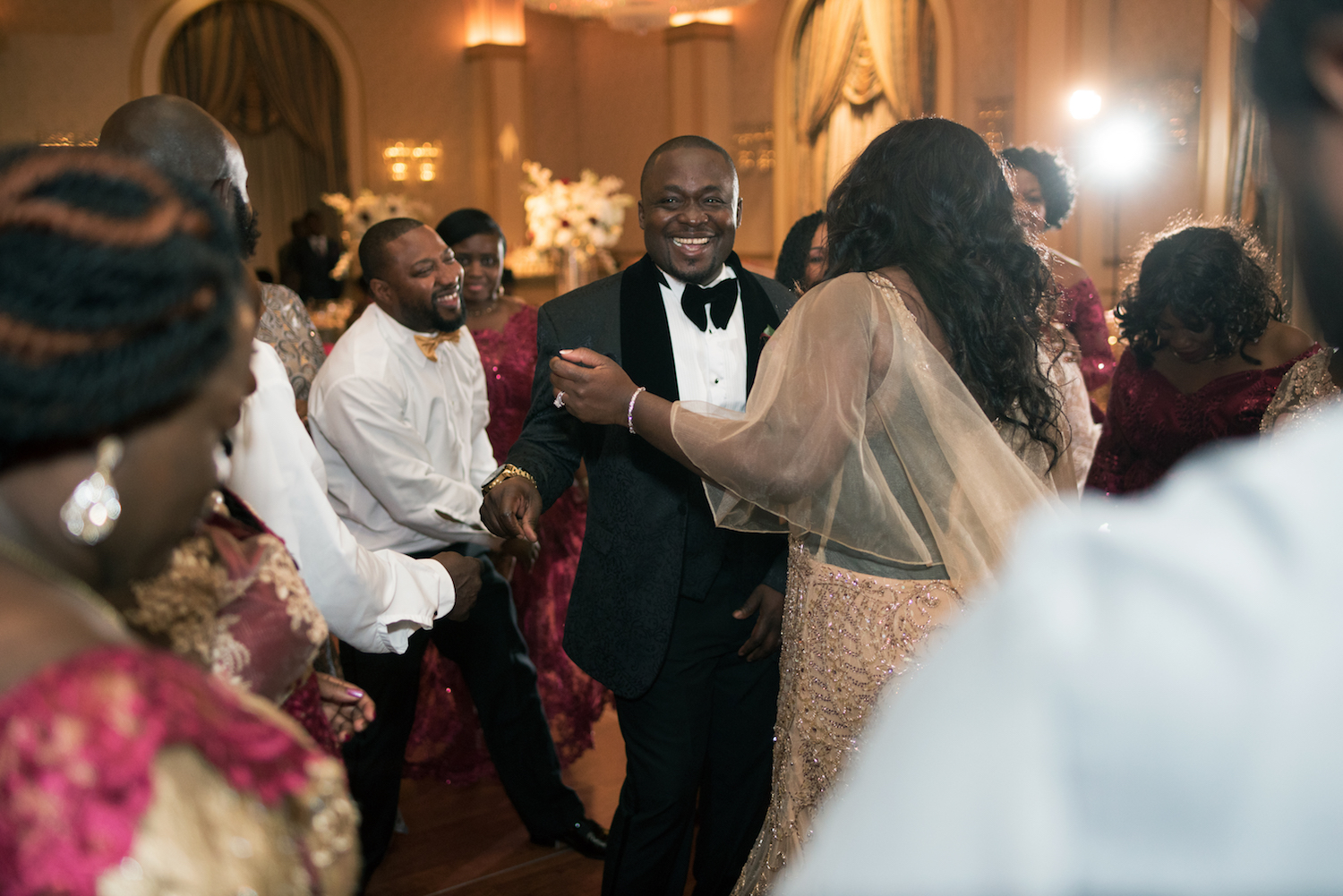 anita&dela-dancing-with-guests-wedding-photography-nj
