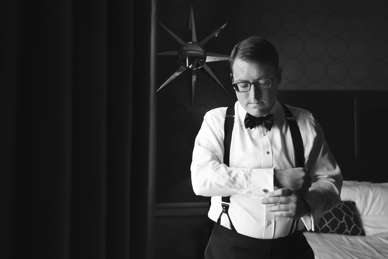 brian-putting-on-cuff-link-groom-prep-wedding-photography-ny