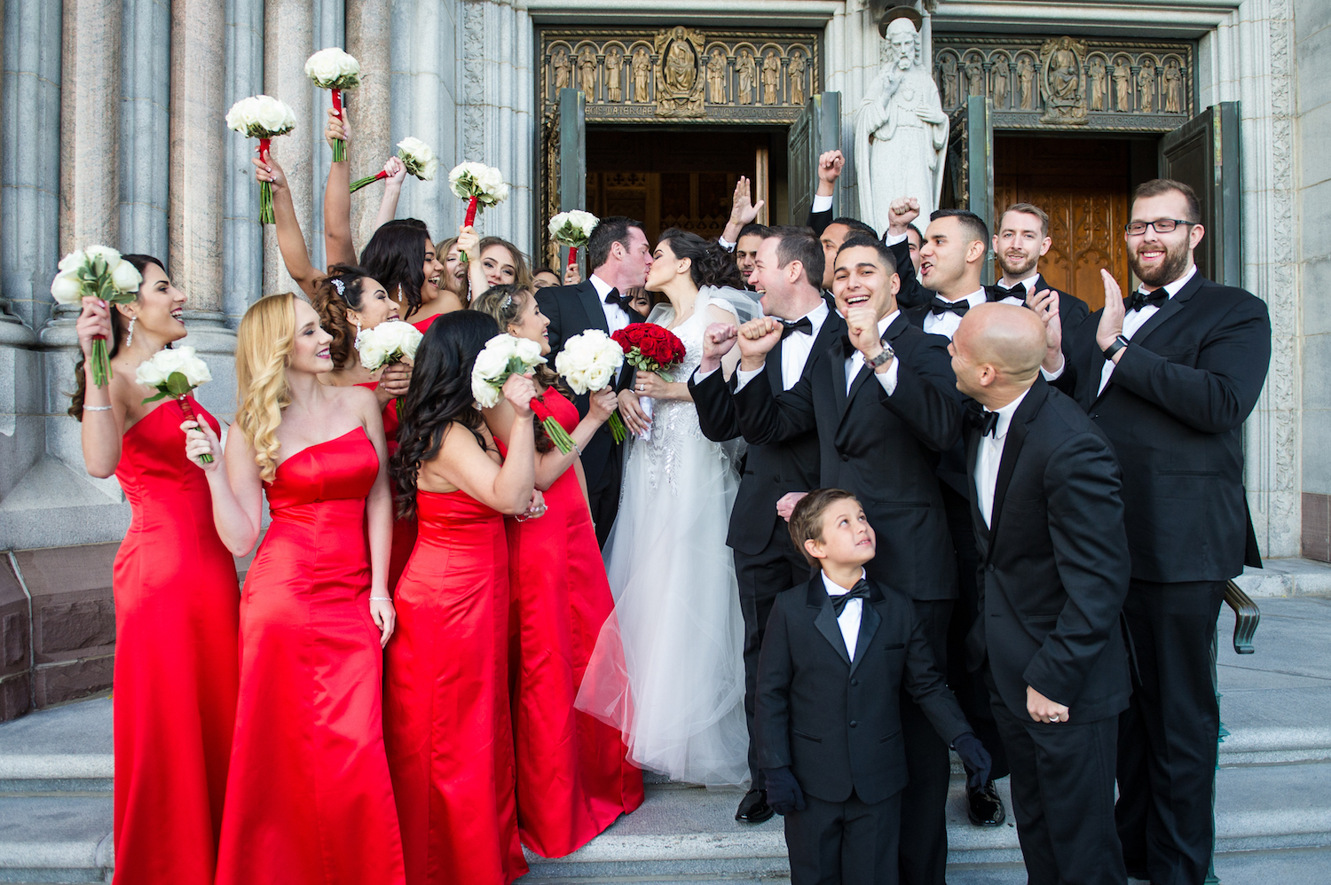 christian&jessica-kissing-outside-church-wedding-party-nj-photography