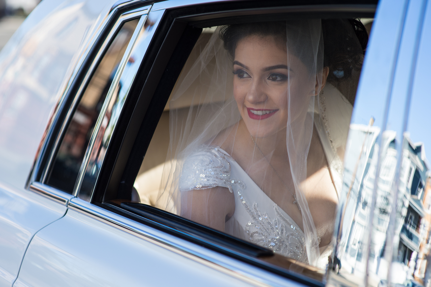jessica-in-dress-looking-out-car-window-ceremony-wedding-photography-nj