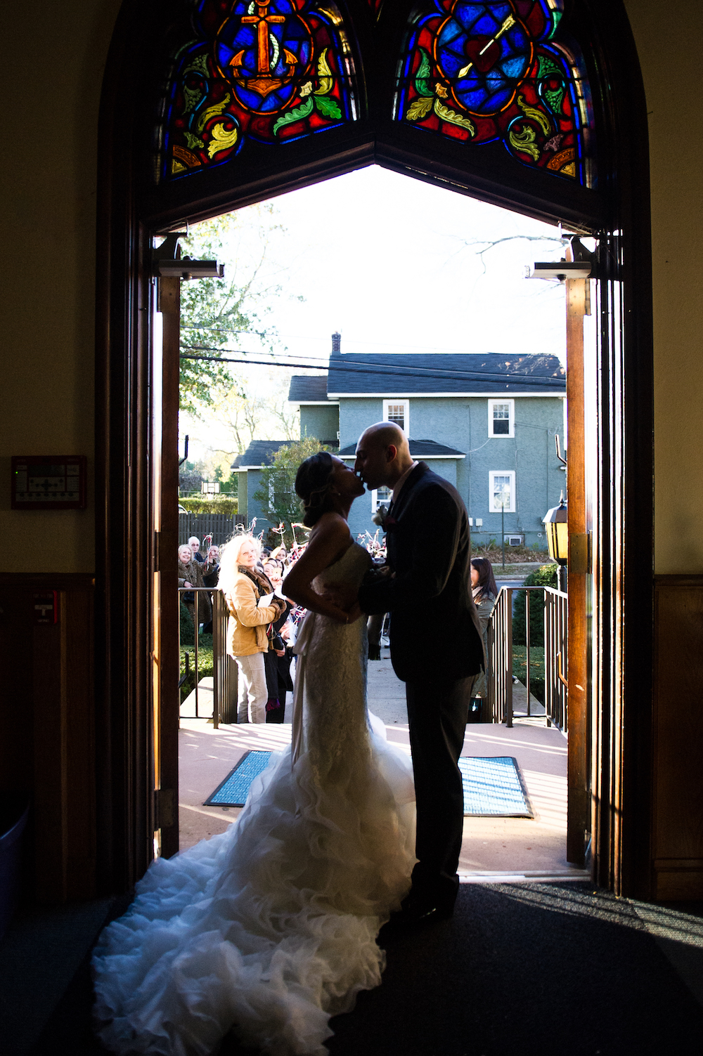 leah&frank-kissing-in-church-doorway-after-ceremony-wedding-photography-nj