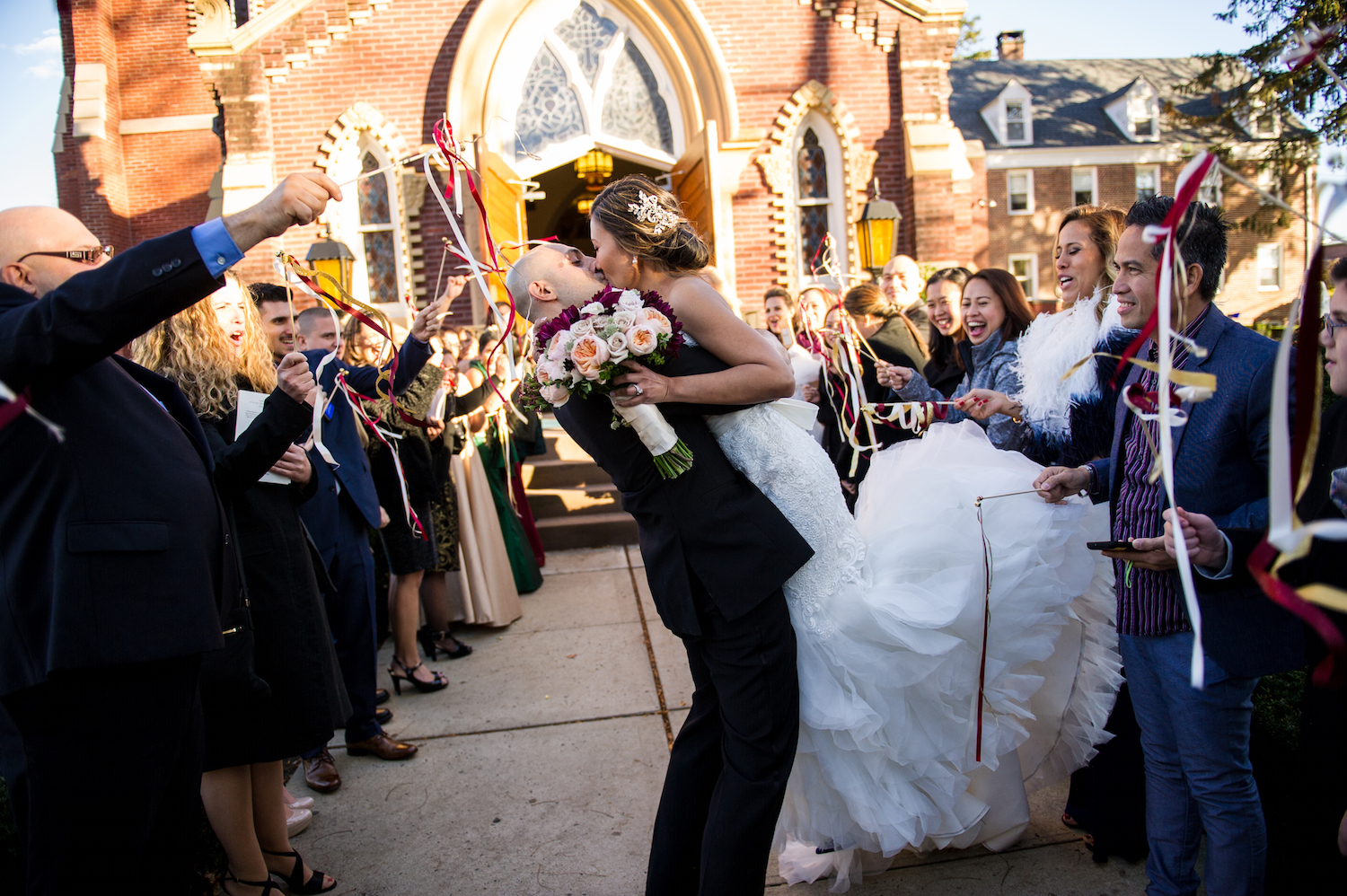 lean&frank-kissing-outside-church-surrounded-by-cheering-guests-nj-wedding-photos