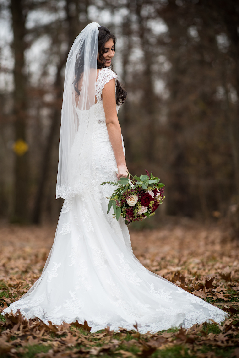 marissa-in-dress-holding-bouquet-wooded-area-wedding-photography-nj