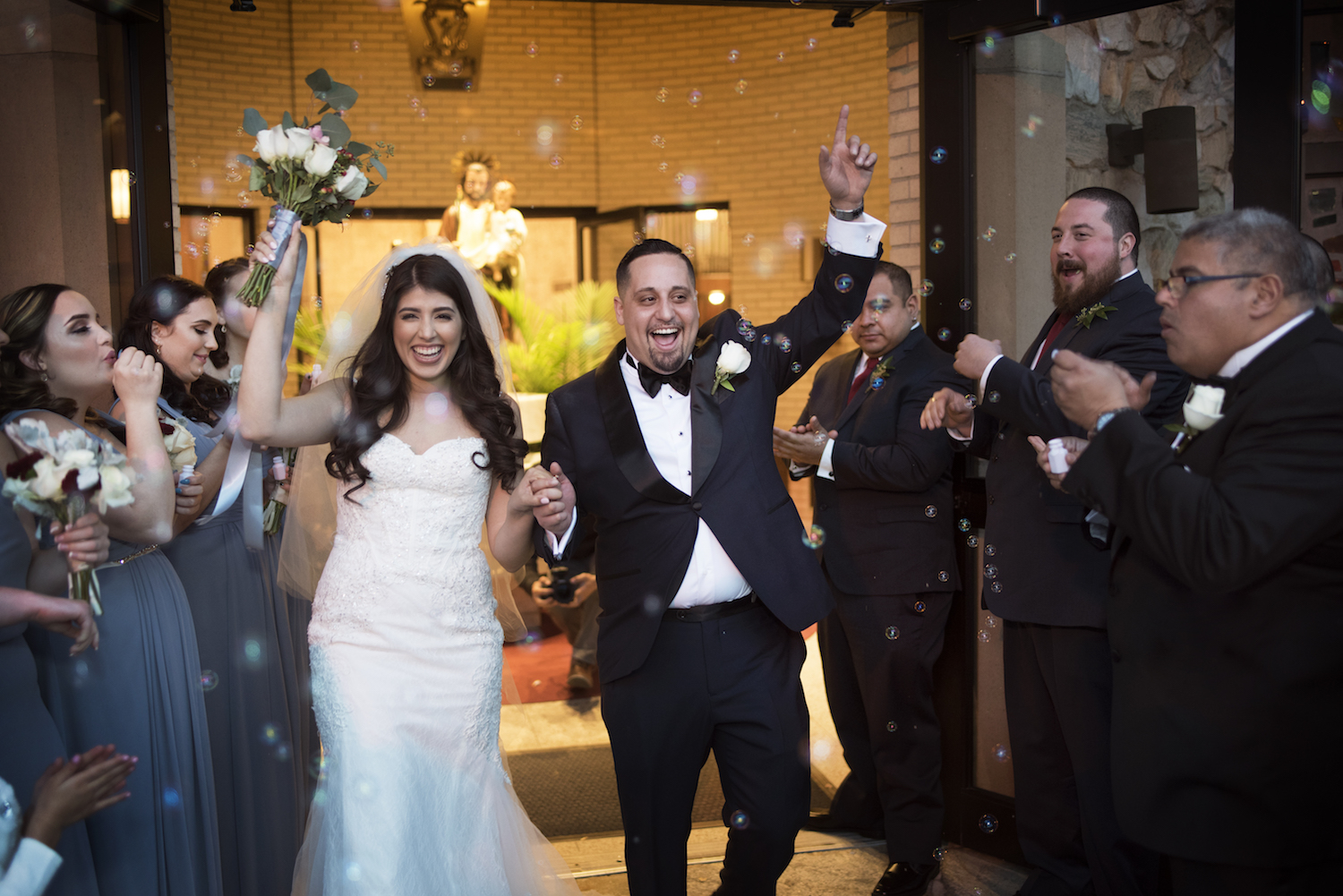 sylvia&alejandro-cheering-walking-down-aisle-church-ceremony-nj-wedding-photography