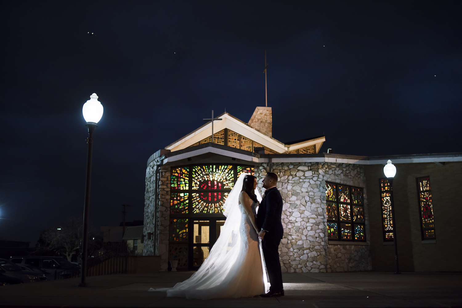 sylvia&alejandro-holding-hands-outside-night-lamp-post-wedding-photos-nj