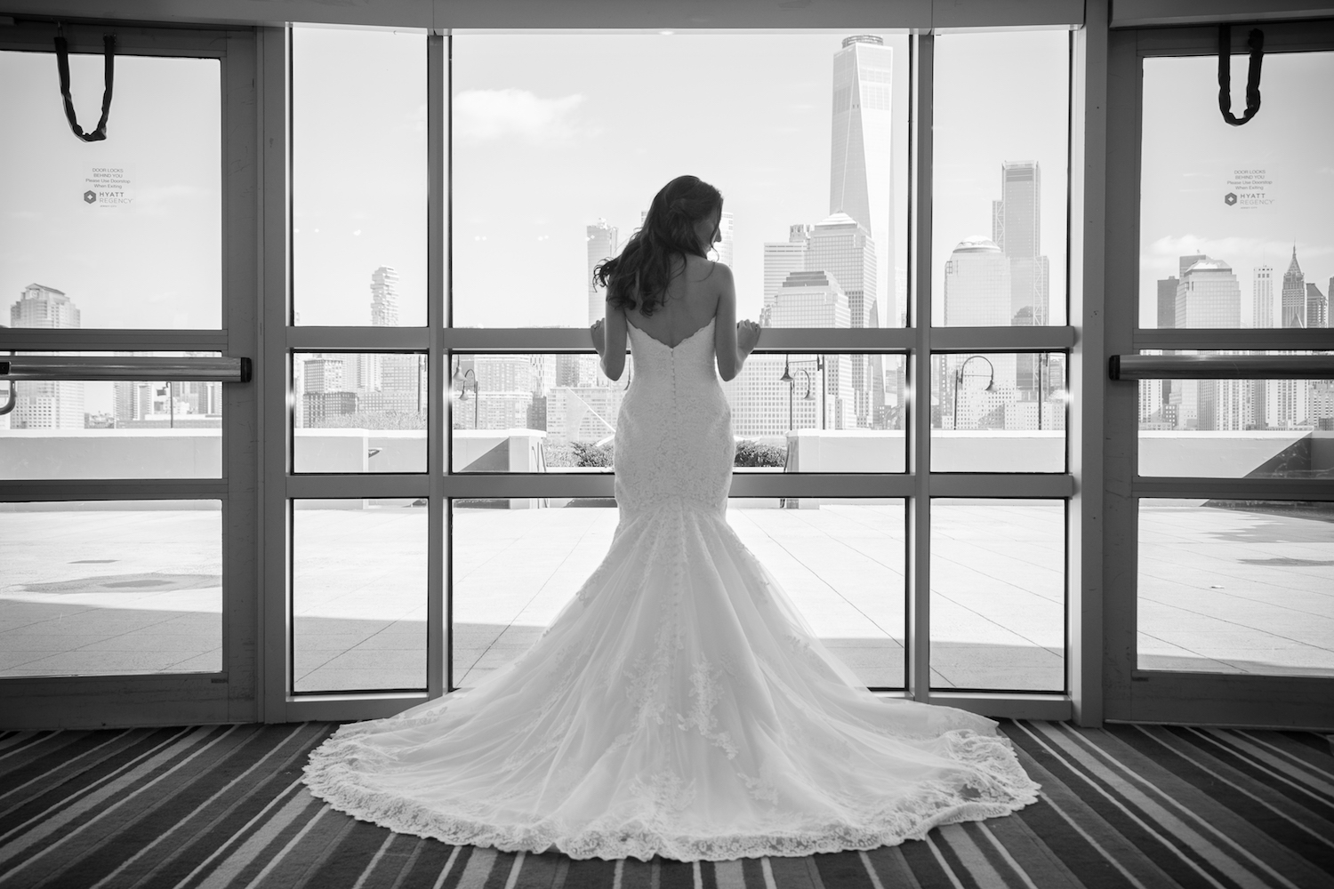 Jacqueline&Cory-standing-at-window-in-dress-wedding-photography-nj