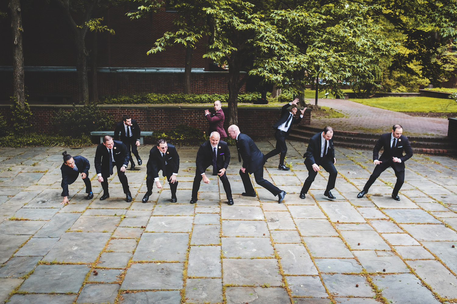 rob-groomsmen-playing-imaginary-football-nj-wedding-photography