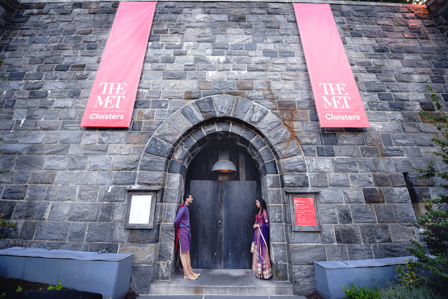 kripa&varun-standing-in-doorway-museum-nyc-engagement-photos