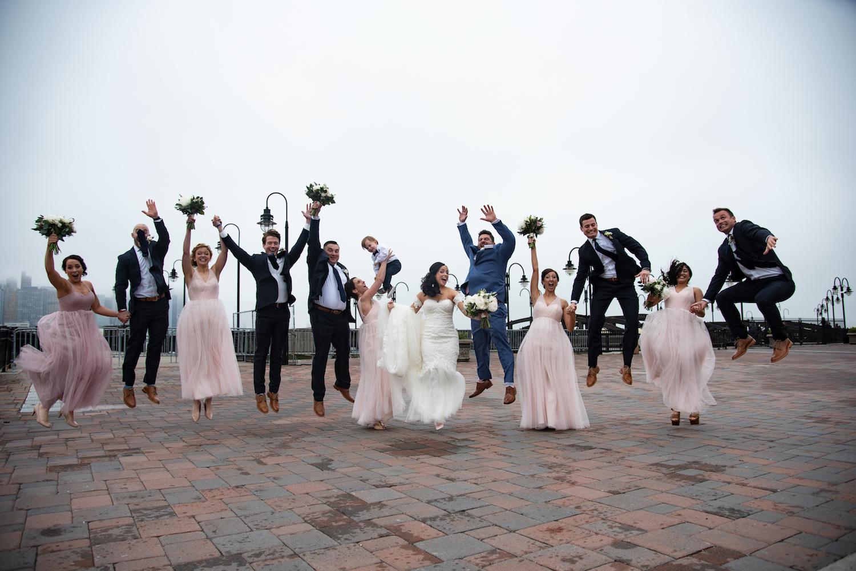 nj-photographers-denise&jason-wedding-party-leaping-outside