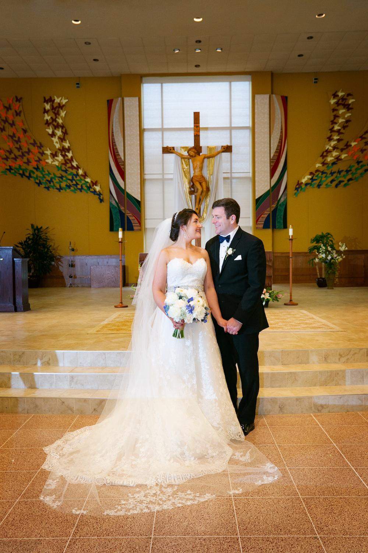 nj-wedding-photographers-caitlin&patrick-standing-smiling-altar-church-ceremony