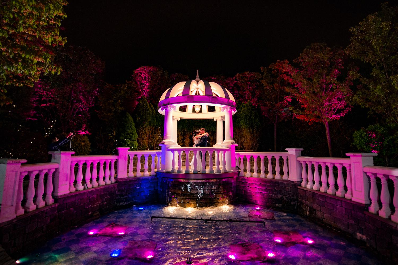 nj-wedding-photographers-james&nicole-embracing-gazebo-grounds-night