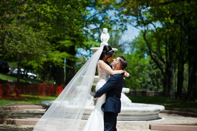 nj-wedding-photographers-james&nicole-lift-kiss-outside-fountain